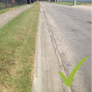 Very clean curb, no grass, no dirt