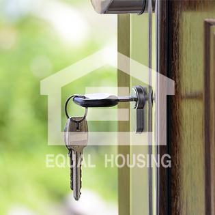 keys in door with fair housing logo