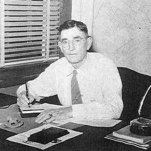 Old photo of man at a desk