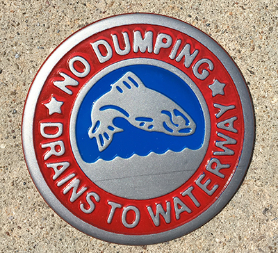 No dumping storm drain marker with fish.