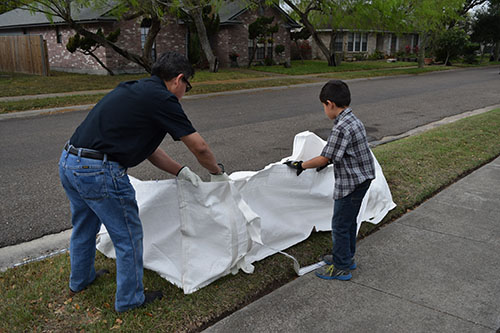 A man and his son opening the super bag